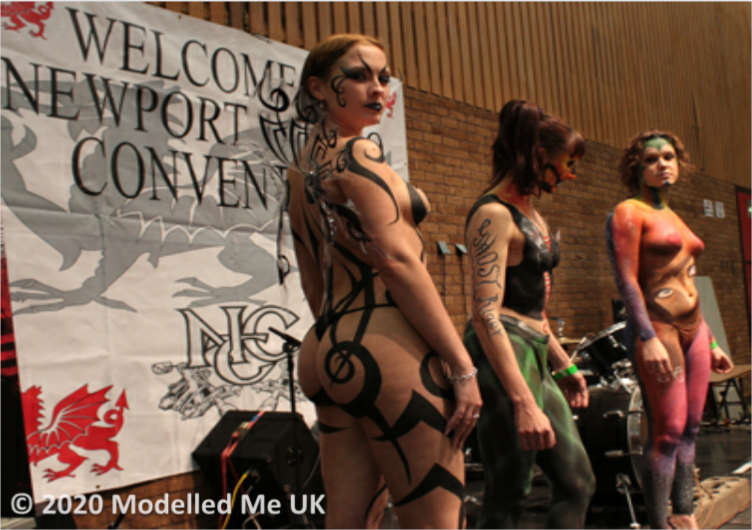 Rosemarie receiving well desrved accolades at the Newport Body Art Convention